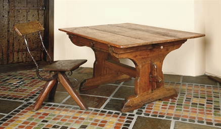 A PINE TRESTLE-END TABLE
