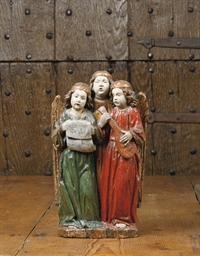 A POLYCHROME CARVED OAK RELIEF