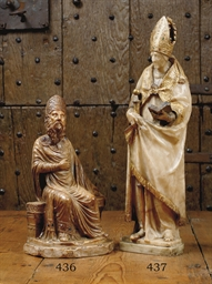 A CARVED ALABASTER FIGURE OF A