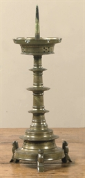A BRASS PRICKET CANDLESTICK