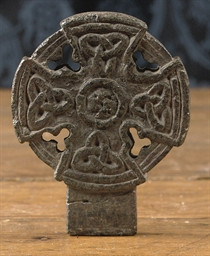 A CARVED STONE CROSS