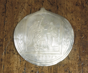 A MOTHER-OF-PEARL RELIEF CARVE