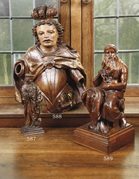A CARVED OAK FIGURE OF MOSES