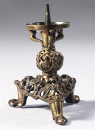 A GILT-BRONZE PRICKET CANDLEST