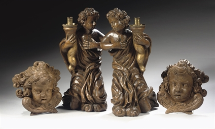 A PAIR OF PARCEL-GILT CARVED O