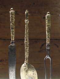 A GILT METAL AND STEEL CUTLERY