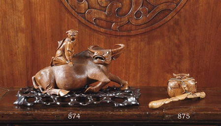 A CHINESE WOOD CARVING OF A BU