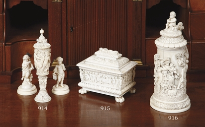 TWO CARVED IVORY FIGURES OF PU