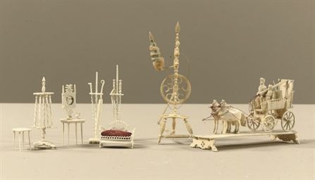 A COLLECTION OF CARVED IVORY D