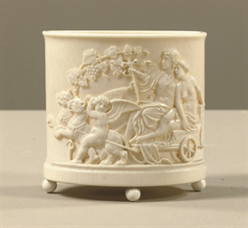 AN OVAL CARVED IVORY CONTAINER