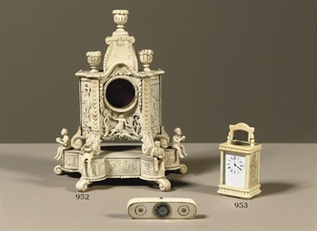 A FRENCH MINIATURE IVORY CARRI