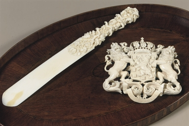 A CARVED IVORY SHOE HORN