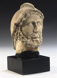A MARBLE HEAD OF A BARBARIAN