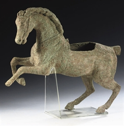A BRONZE FIGURE OF A PRANCING