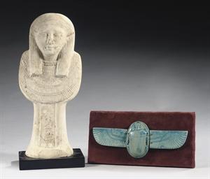 AN EGYPTIAN-STYLE LIMESTONE HA