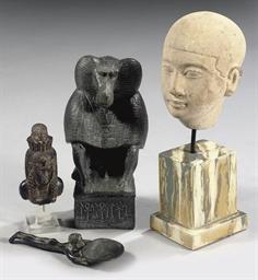 AN EGYPTIAN-STYLE LIMESTONE HE