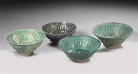 FOUR KASHAN BOWLS WITH MOULDED