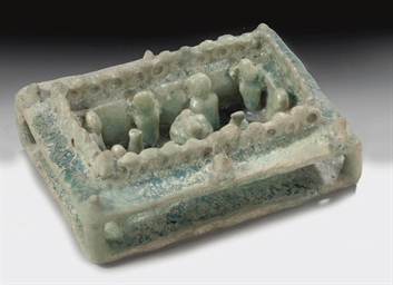 A TURQUOISE GLAZED MOULDED COU