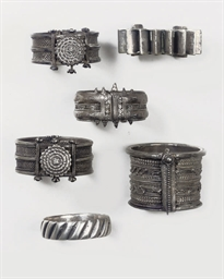 A GROUP OF SILVER BRACELETS, I