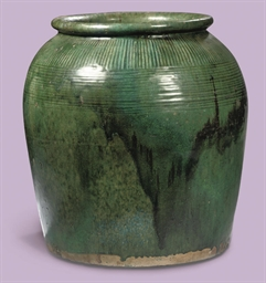 A LARGE CHINESE GREEN-GLAZED M