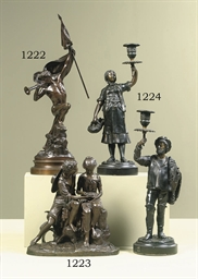 A FRENCH BRONZE GROUP OF A BOY
