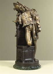 A PATINATED AND GILT-SPELTER F