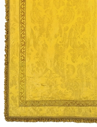 A COVERLET OF YELLOW SILK DAMA