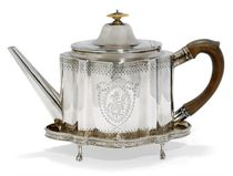 A GEORGE III PROVINCIAL SILVER TEAPOT AND STAND