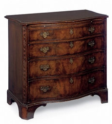 A MAHOGANY SERPENTINE CHEST