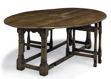AN OAK DOUBLE GATE-LEG DINING