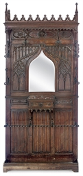 A FRENCH CARVED WALNUT HALL-ST