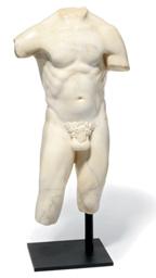 A WHITE MARBLE TORSO OF A MAN