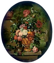 Chrysanthemums, roses and other flowers in a sculpted urn, on a ledge
