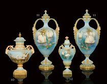 A PAIR OF TWO-HANDLED VASES AND COVERS BY CHARLEY BALDWYN