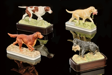 FOUR MODELS OF DOGS FROM THE '