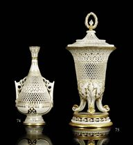 A RETICULATED VASE AND COVER BY GEORGE OWEN