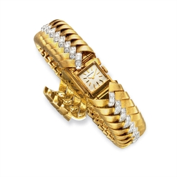 A GOLD AND DIAMOND BRACELET WA