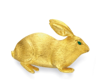 A GOLD AND EMERALD RABBIT