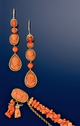 A pair of coral earrings and a