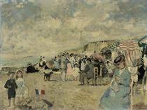 Marie-Lize et Jean-François devant le château de sable sur la plage d'Etretat (station balnaire de Seine Maritime)