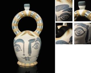 Vase aztèque aux quatre visage