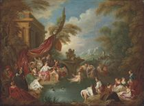 An extensive landscape with women bathing in a wooded enclosure by ruins