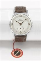 Doxa. A stainless steel wristwatch with two-tone silvered dial, original sales tag and box