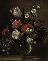 Morning glory, tulips, carnations and other flowers in a glass vase on a ledge