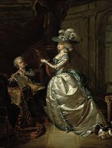 An elegant couple making music in an interior