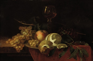 An orange, a peach, grapes and
