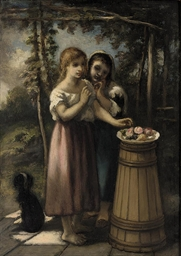 Two girls by a fruitbowl