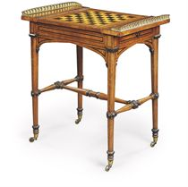 A REGENCY BRASS-MOUNTED, EBONISED AND EBONY-INLAID OAK AND BROWN OAK GAMES-TABLE