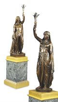 TWO FRENCH PATINATED BRONZE FIGURAL TORCHERES, ENTITLED 'FEMME INDIENNE' AND 'ESCLAVE INDIEN'