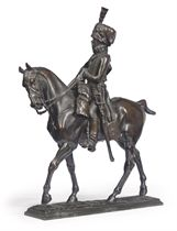 A RUSSIAN BRONZE GROUP OF A HUSSAR
